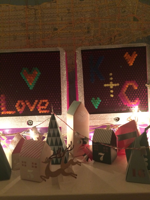 "More ""Elf"" decorations and our advent calendar village - a crucial part to Kevin's proposal :)"