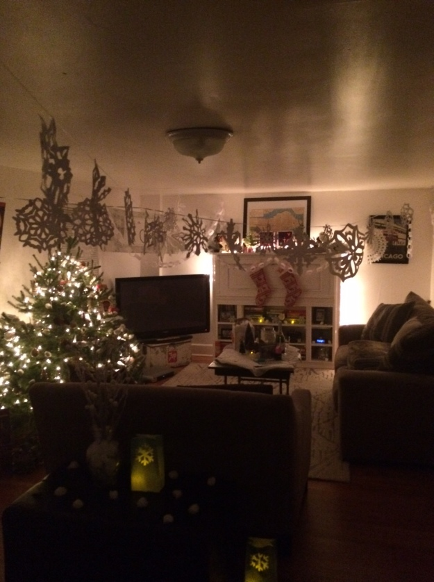 "Our living room was ""Elfed"" thanks to Kevin's mom and his seriously talented decorating squad family"